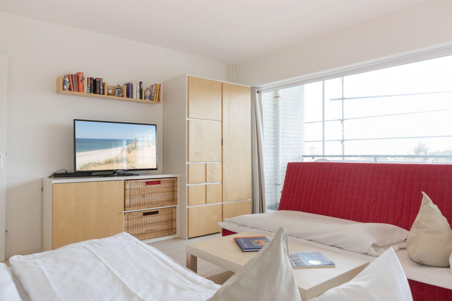 Wohnzimmer mit Schlafsofas