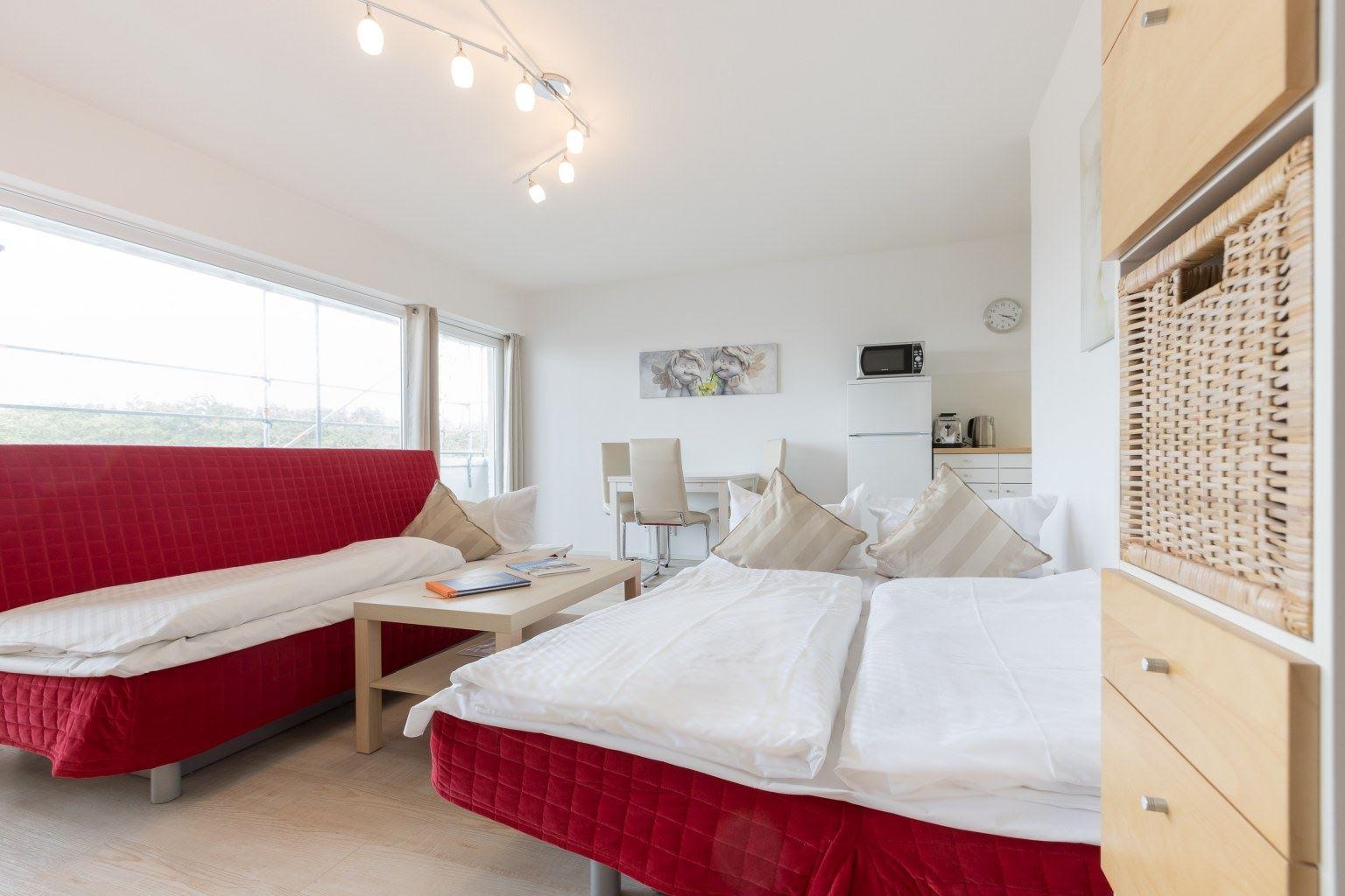 Wohnzimmer mit Schlafsofas - Haus Luv und Lee, Wohnung 28, Im Bad 18, St. Peter-Bad