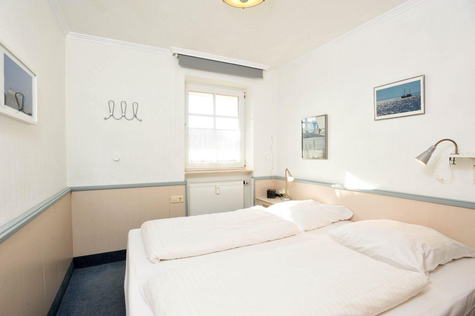 """Schlafzimmer """"Meer und Sonne"""", Strandläuferweg 10, St. Peter-Bad"""