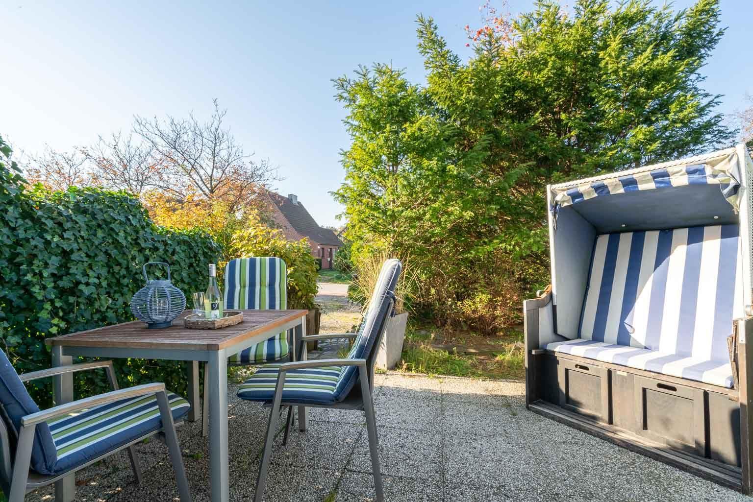 "Terrasse - St Peter Ording Dorf, Ferienhaus Groener Weg 9, Wohnung 1 ""Duenensonne EG"""