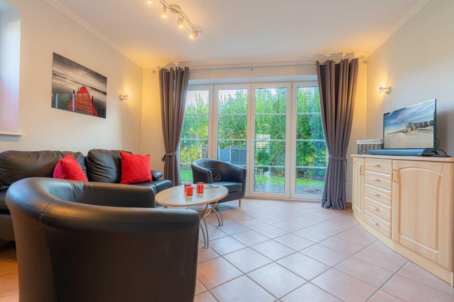 Wohnzimmer mit Terrasse und Kaminofen